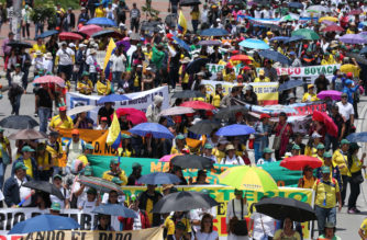Striking teachers protest a preliminary agreement between the teachers' union and the government, regarding working conditions, during a march in Bogota, Colombia, Wednesday, May 6, 2015. Teachers want a 16% raise, but the agreement includes a 12% increase. Teachers also disagree with obligatory annual evaluations, which would determine pay raises. Currently, exams are taken by teachers specializing in an area, which determines any salary increases, but they are voluntary. (AP Photo/Fernando Vergar